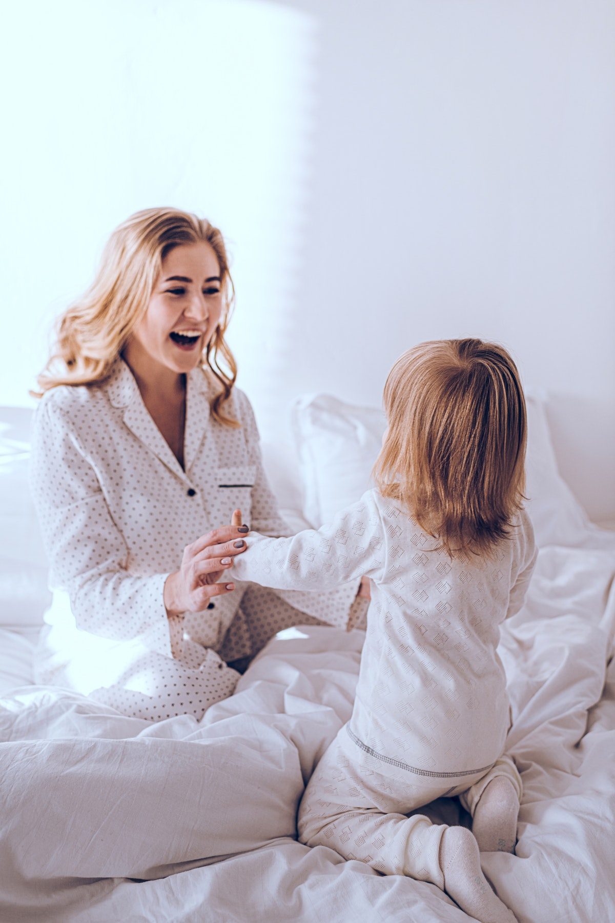 A jewelry designer spend the a.m. with her children before starting work.