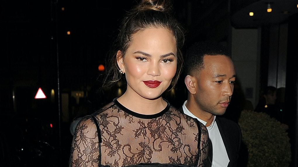 Chrissy Teigen steps out in a sheer lace shirt.