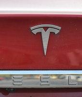Tesla emblem on the back of a Model S electric car.