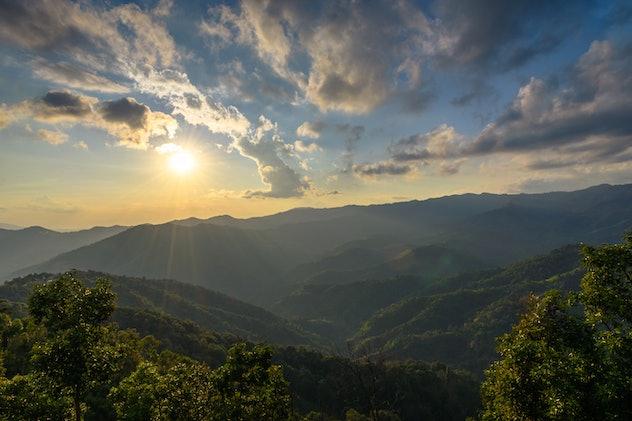 Sunset over green hills.