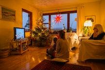 family watching christmas movie