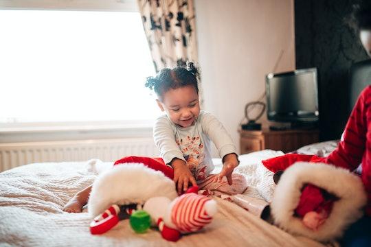 Little girl opening stockings.