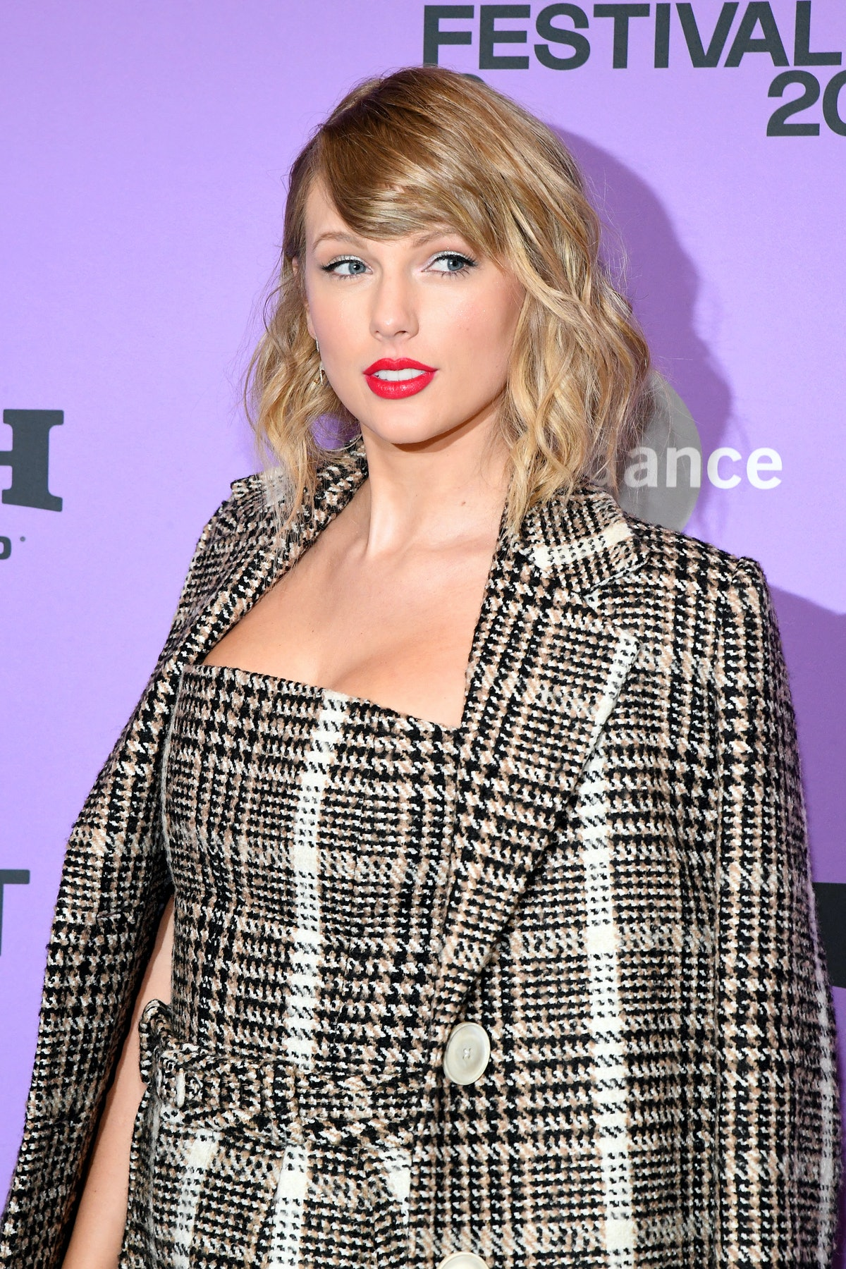 Taylor Swift hits the red carpet in plaid.