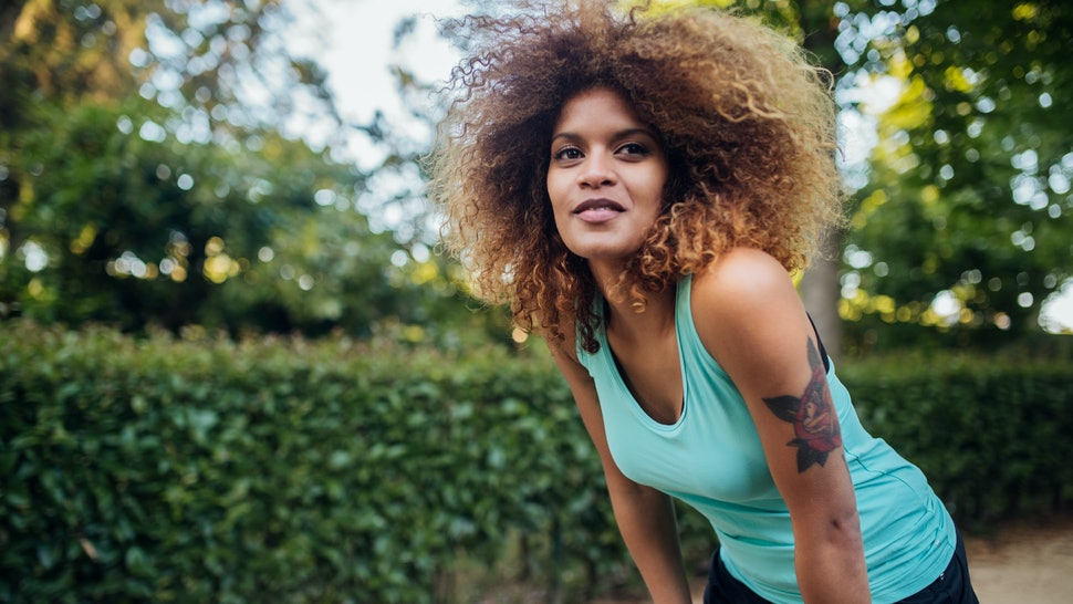 A woman goes for a run in the park. Exercising is just one way to protect your heart health in your 20s and 30s.