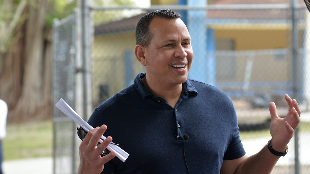 Alex Rodriguez flashes a smile for cameras.