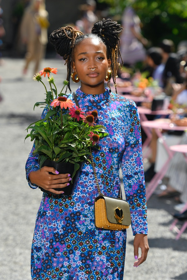 A model at the Kate Spade Spring 2020 fashion show rocks the floral, wallpaper print trend.