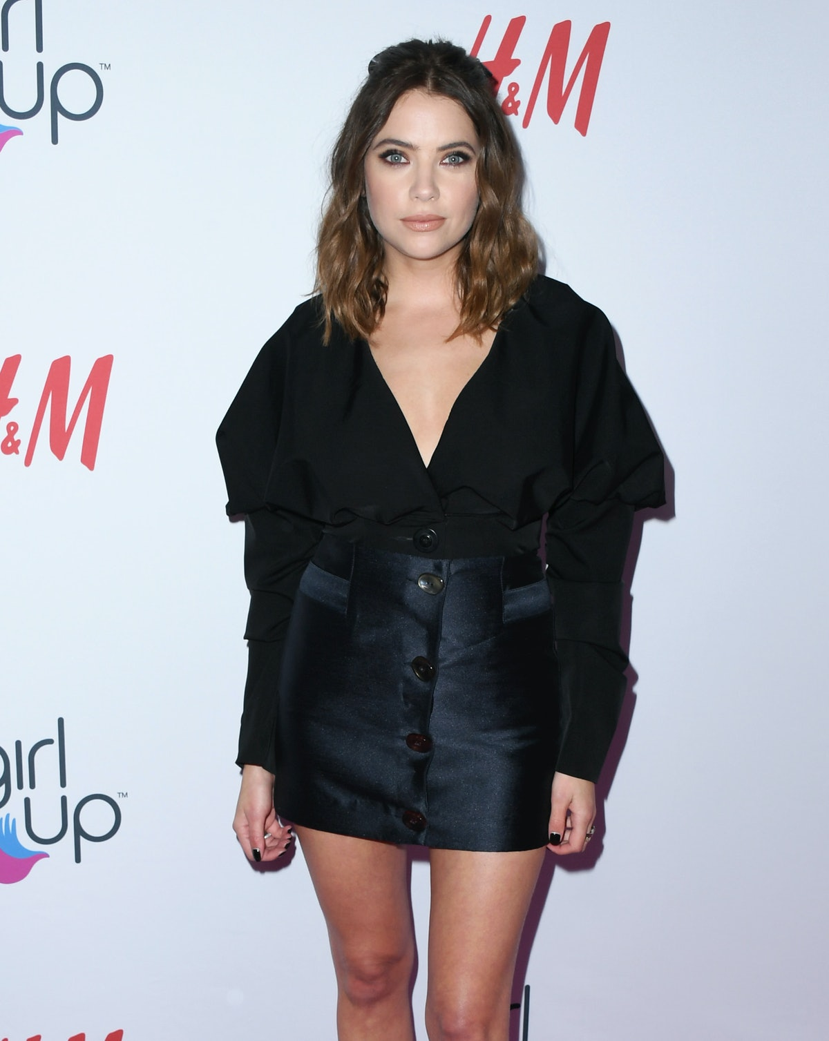 Ashley Benson's long, brown hair is different from her usual shorter hairstyle