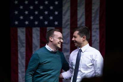 South Bend, Indiana Mayor Pete Buttigieg shares a smile with his husband during a campaign event.