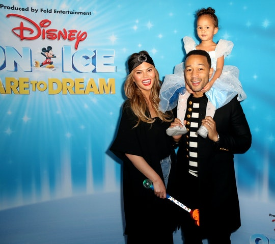 Chrissy Teigen, john legend, and luna