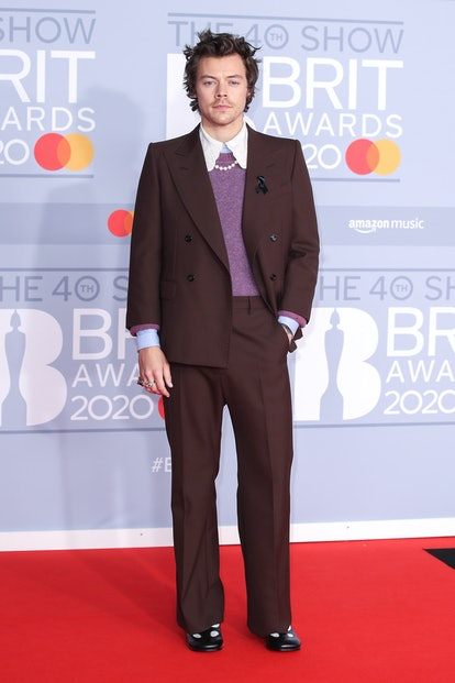 Harry Styles' 2020 Brit Awards look featured bedhead and pearls.