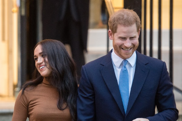 Meghan Markle and Prince Harry step out hand in hand.