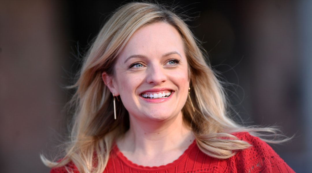 Elisabeth Moss' orange eyeshadow and black dress at 'The Invisible Man' photocall.