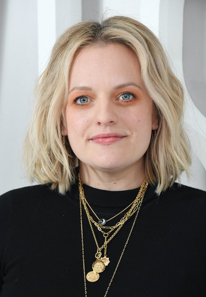 Elisabeth Moss' orange eyeshadow and coral lip.
