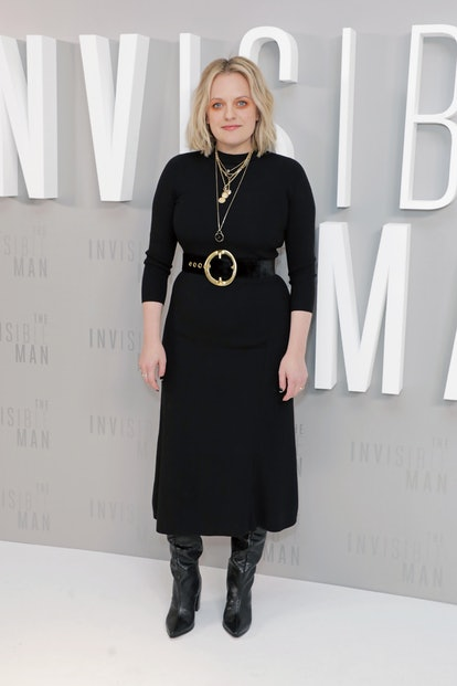 Elisabeth Moss' orange eyeshadow, black dress, and black boots.