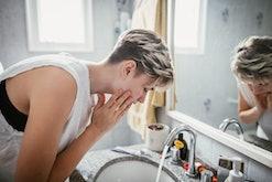 woman washing face as good hygiene