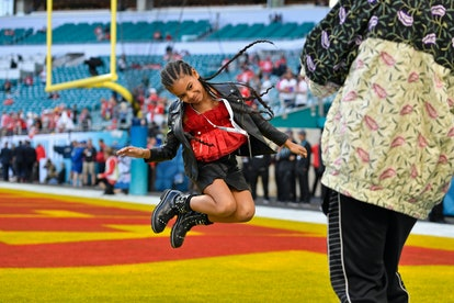 Jay-Z snapped a photo of Blue Ivy jumping at the 2020 Super Bowl in Miami.