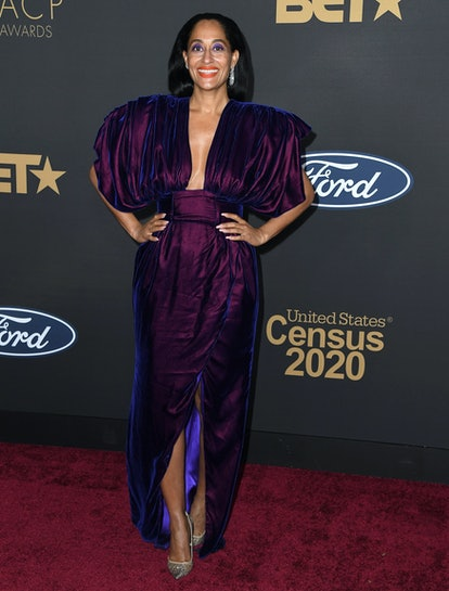 Tracee Ellis Ross at the NAACP Image Awards wearing bright purple eyeshadow and matching purple dress
