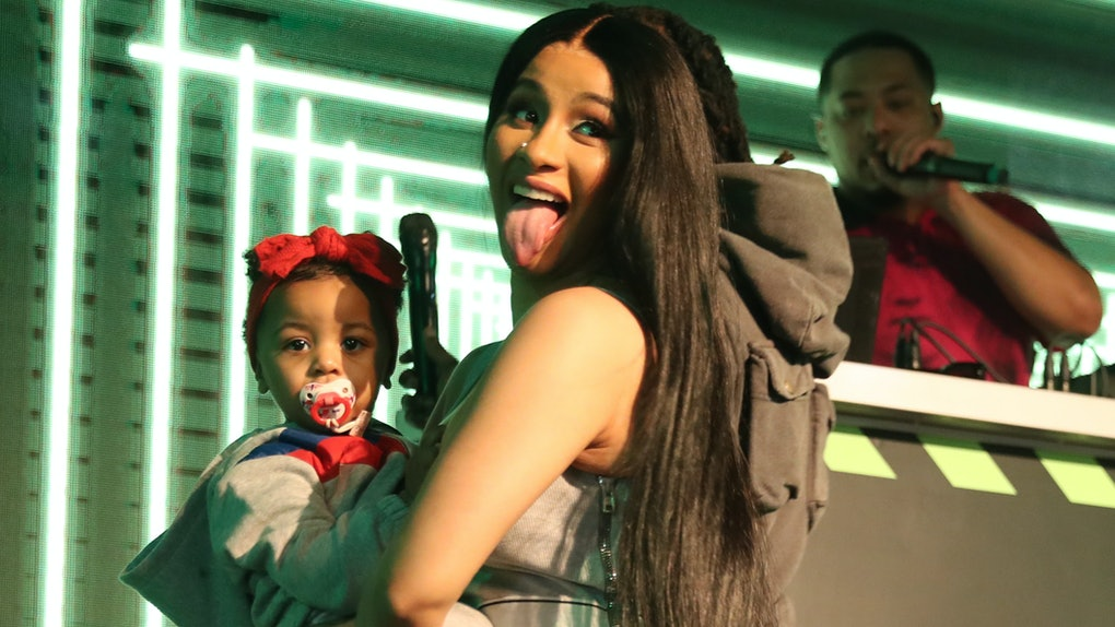 Cardi B dances onstage with her daughter Kulture.