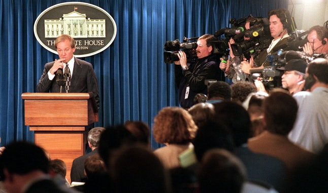 White House Press Secretary Mike McCurry, surrounded by the media, answers questions Jan. 22, 1998 d...