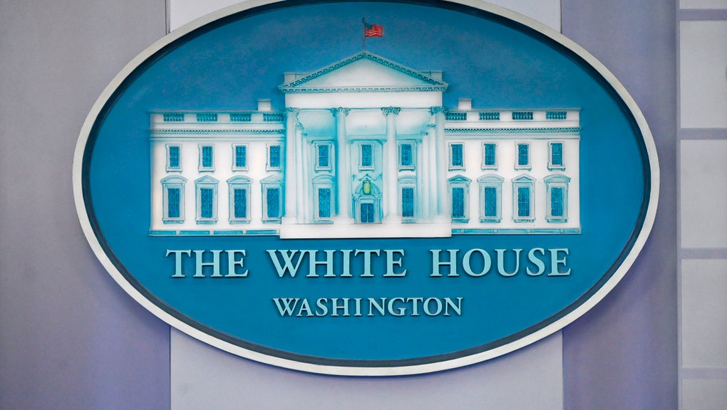 The White House logo is displayed in the press briefing room of the White House in Washington, D.C. ...