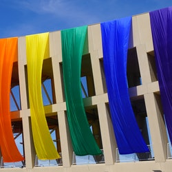 A rainbow flag hangs on a monument in Salt Lake City, Utah. Utah is one of the most conservative states to pass a conversion therapy ban.