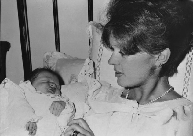 Princess Birgitta of Sweden looks down at her sweet baby in the 1960s inside this Munich hospital.