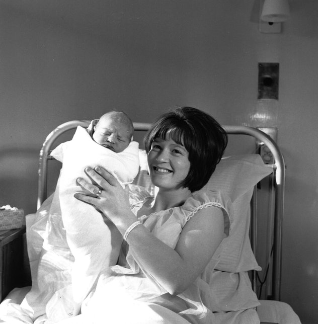This 1965 mom holding up her baby for the camera proudly is just so sweet.