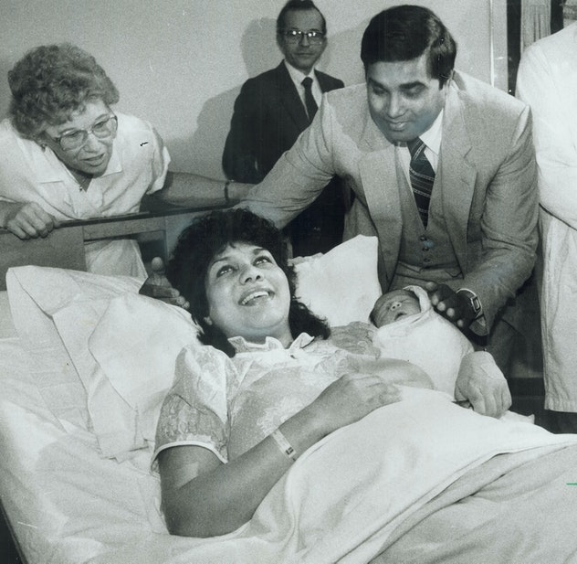 """This 1984 photo of the first """"test tube"""" baby shows pure joy on the mother's face in her hospital bed."""