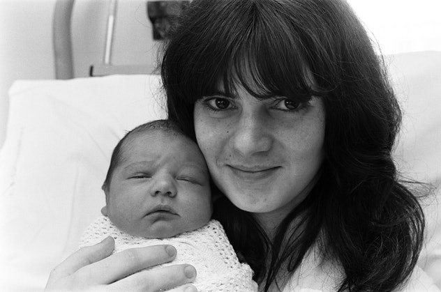 A 1975 portrait of a brand new mom and her brand new baby is just darling.