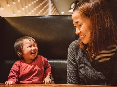 baby laughing at mom