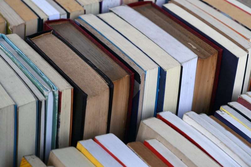 Piles of books. Stress can impact gastritis, as one writer learned during a particularly challenging...