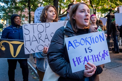 """A person holds a sign saying """"Abortion is Health Care."""" It will now be easier to access reproductive health care in Virginia."""