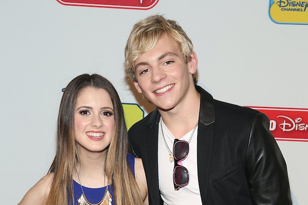 Laura Marano and Ross Lynch pose for a photo.