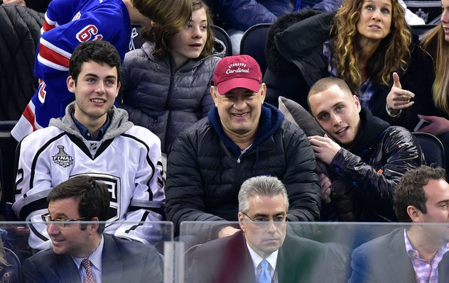 Tom Hanks was having a blast with his sons Chet and Truman at a hockey game in 2015.