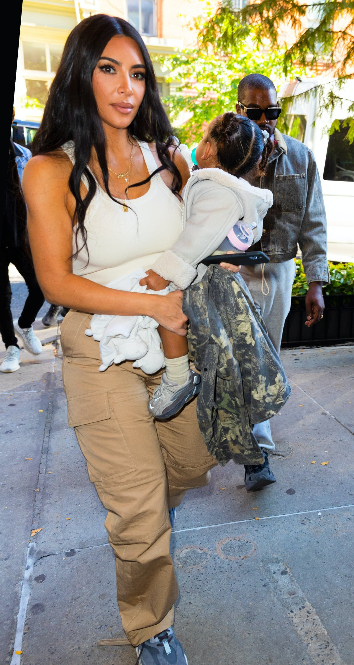 Kim Kardashian steps out with Chicago West and Kanye West.