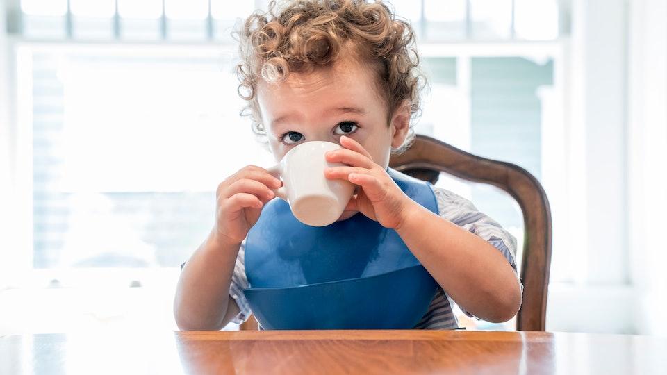 a toddler boy drinking tea