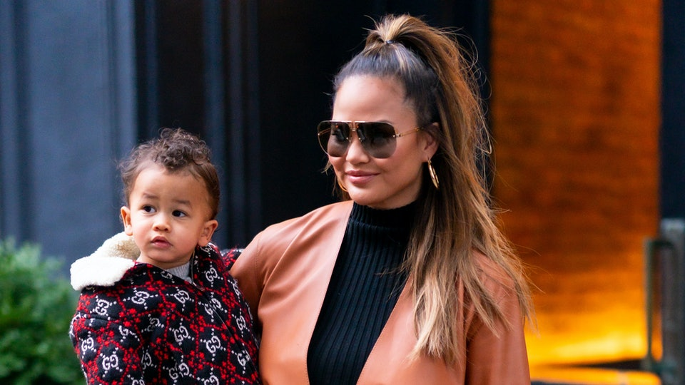 Chrissy Teigen did yoga with Miles crawling all over her.