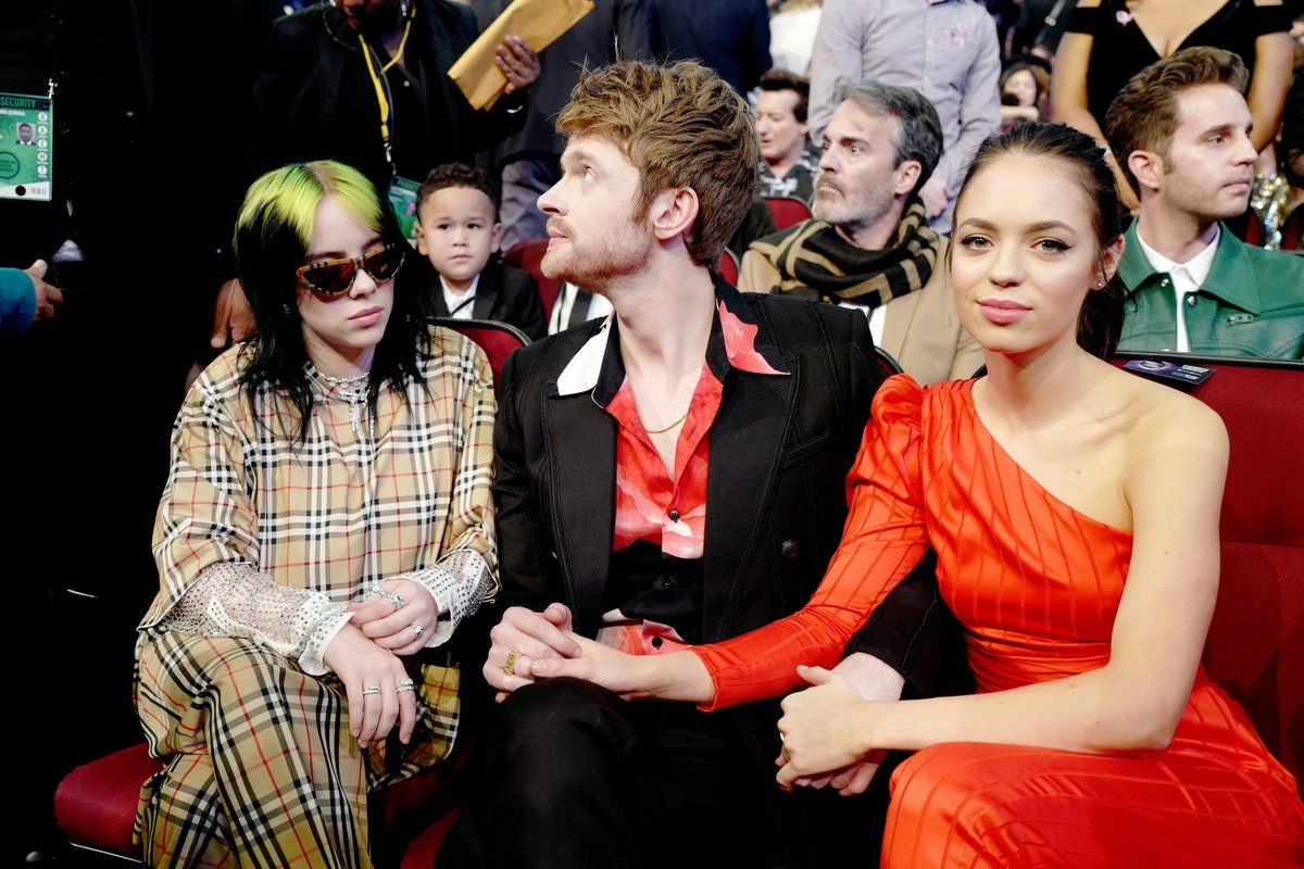 Billie Eilish, Finneas O'Connell, and Claudia Sulewski attend the AMAs.