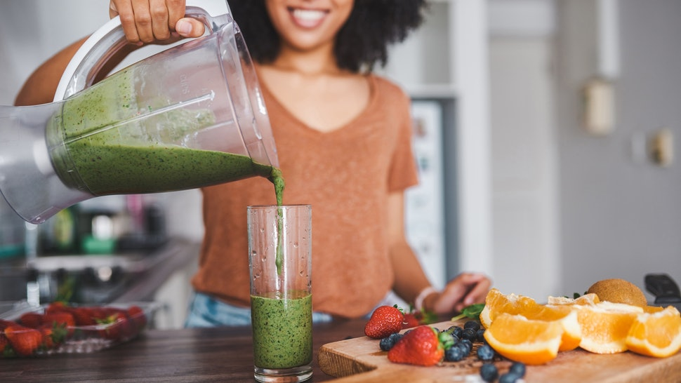A woman makes a green juice as part of her nutritionist-backed plan to become vegetarian