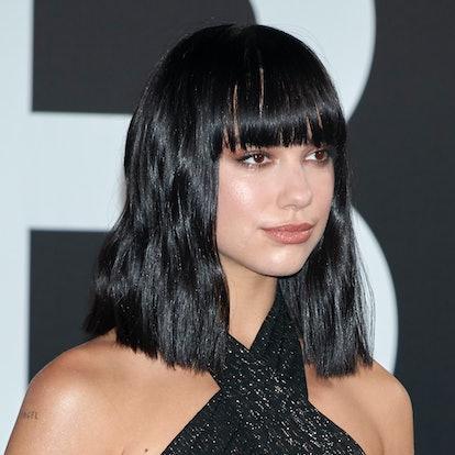 Dua Lipa's bangs are blunt and cut just below the eyebrows
