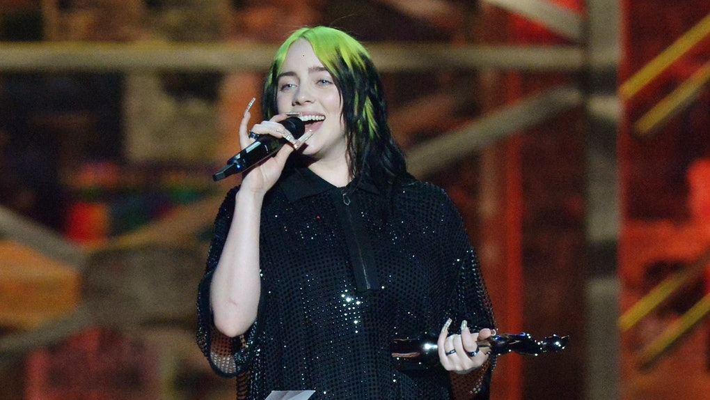 Billie Eilish accepts an award.