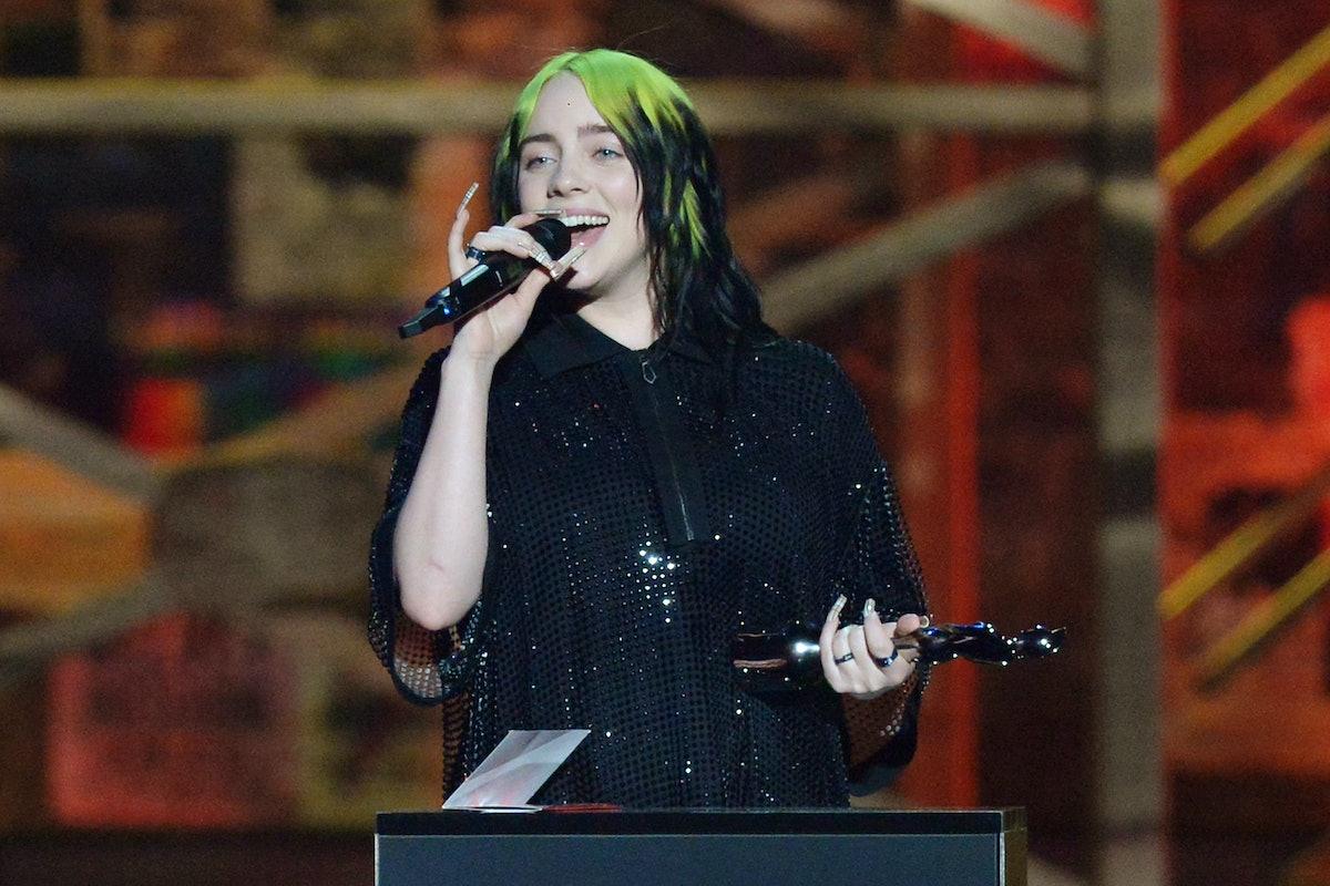 Billie Eilish accepts an award.