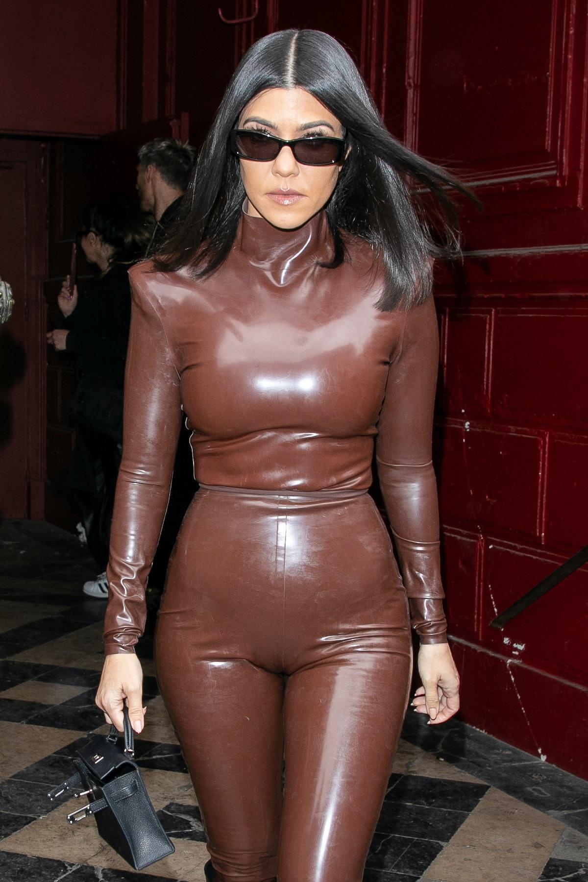 Kourtney Kardashian steps out in a latex bodysuit.