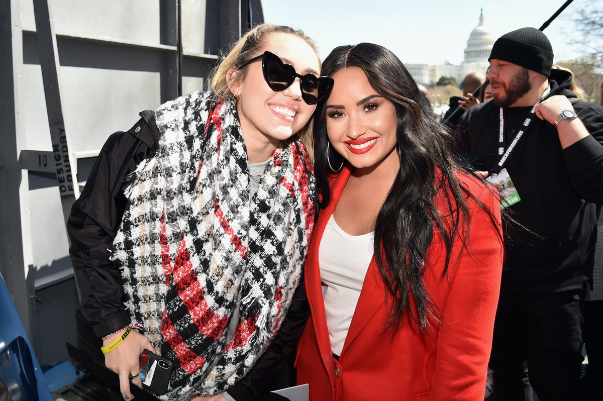 Miley Cyrus and Demi Lovato pose for a snapshot.