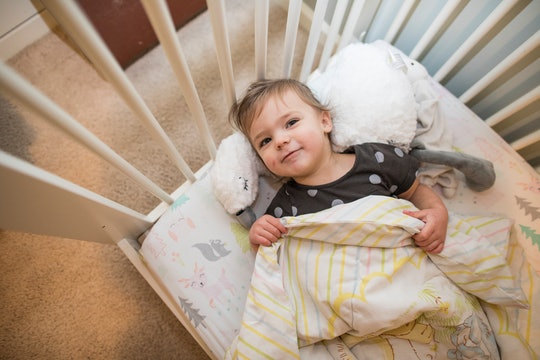 Toddler sleeping in the bed