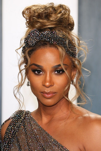 Ciara's hairstylist used a bedazzled head wrap to add interest to her high messy bun