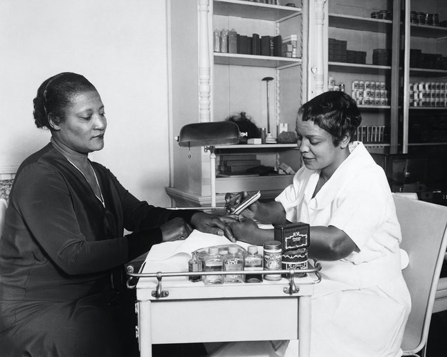 A'Lelia Walker, daughter of Madame C. J. Walker, gets a manicure at one of her mother's beauty shops
