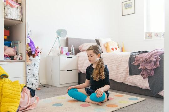 girl meditating in bedroom