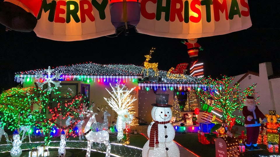 People in self-isolation are trying to spread cheer with Christmas lights.