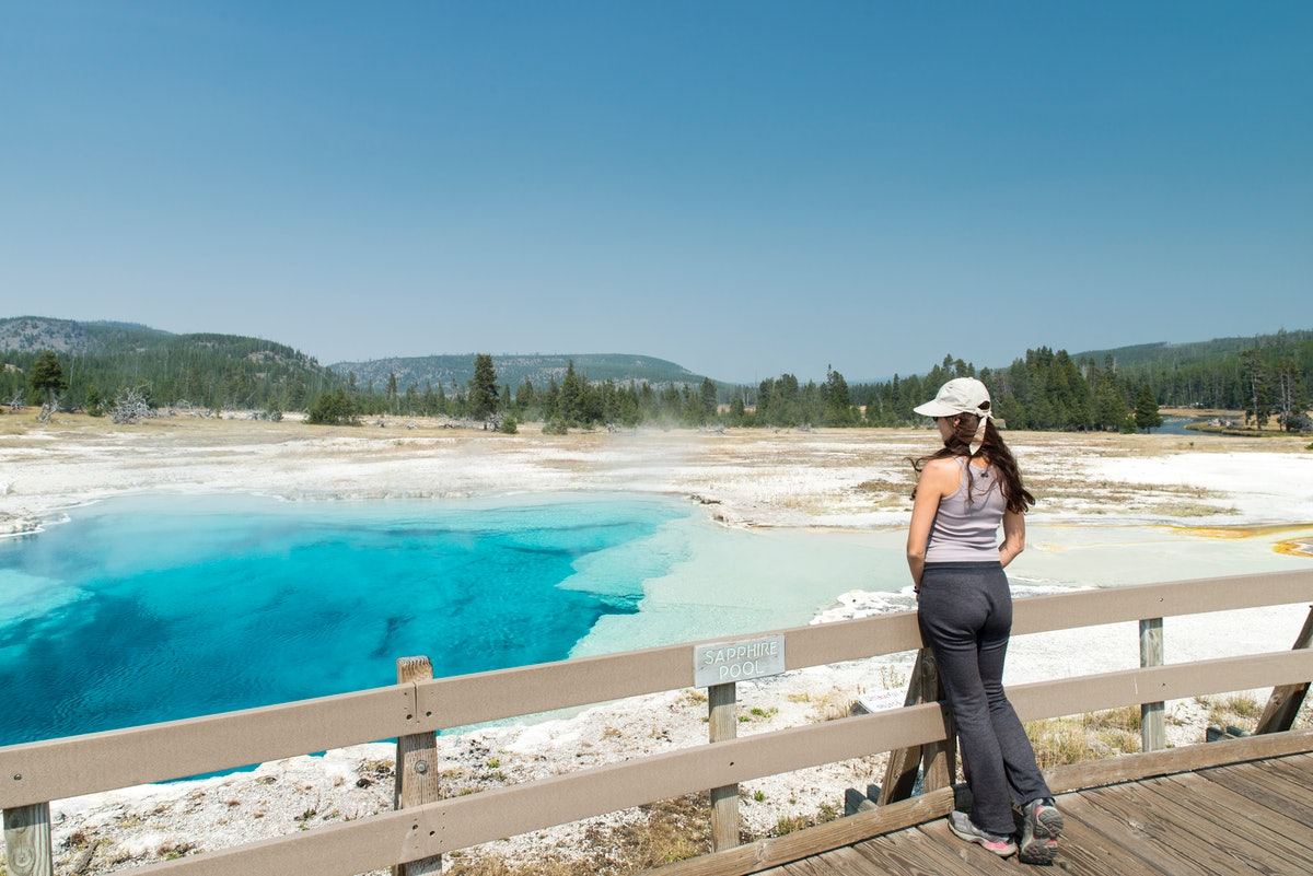 A young woman looks over the basins in Yellowstone National Park.